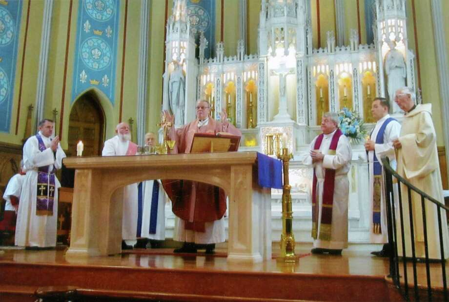 Bishop Edward Scharfenberger celebrates mass at St. Mary's during the church's 150th anniversary on Dec. 17, 2017, in Ballston Spa, N.Y. (Kathleen G. Hedgeman)