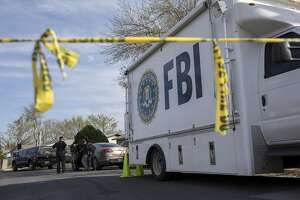 An FBI vehicle is parked on a street where a package bomb exploded the day before, in Austin, Texas, March 13, 2018. In the span of 10 days in Austin, two people have been killed and three people injured in a series of separate package explosions so powerful that the reverberations shook the windows and walls blocks away. (Tamir Kalifa/The New York Times)