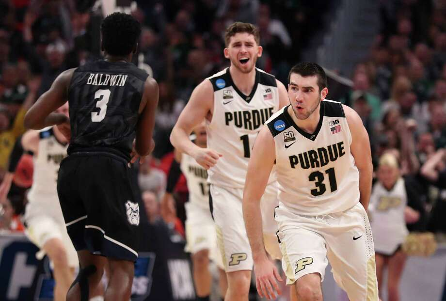 Purdue guards Ryan Cline and Dakota Mathias (31) celebrate as their team defeats Butler during the second half of a second-round game in the NCAA college basketball tournament, Sunday, March 18, 2018, in Detroit. (AP Photo/Carlos Osorio) Photo: Carlos Osorio / Copyright 2018 The Associated Press. All rights reserved.
