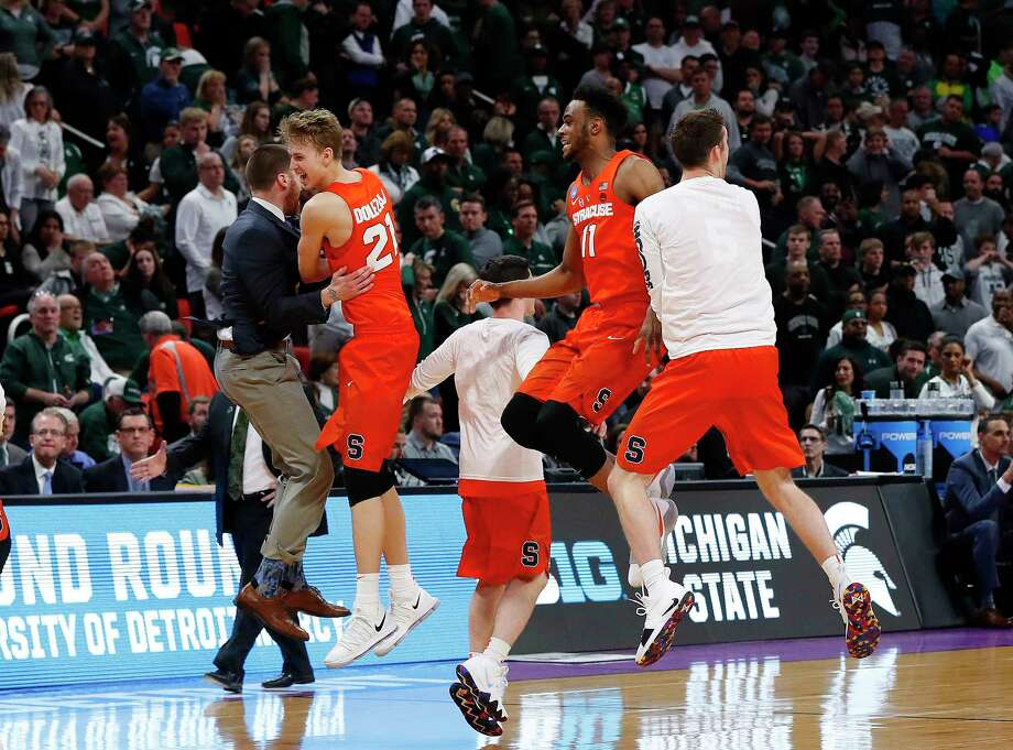 Syracuse players, including Marek Dolezaj (21) and Oshae Brissett (11), celebrate after holding off Michigan State 55-53 on Sunday. Photo: Paul Sancya, STF / Copyright 2018 The Associated Press. All rights reserved.