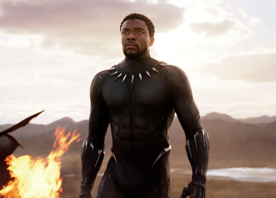 "FILE - This file image released by Disney and Marvel Studios' shows Chadwick Boseman in a scene from ""Black Panther."" ""Black Panther"" has become the first film since 2000's ""Avatar"" to top the weekend box office five straight weekends. According to studio estimates Sunday, March 18, 2018, ""Black Panther"" grossed $27 million in ticket sales over the weekend, pushing its domestic haul to $605.4 million. (Marvel Studios/Disney via AP, File) / Marvel Studios/Disney"