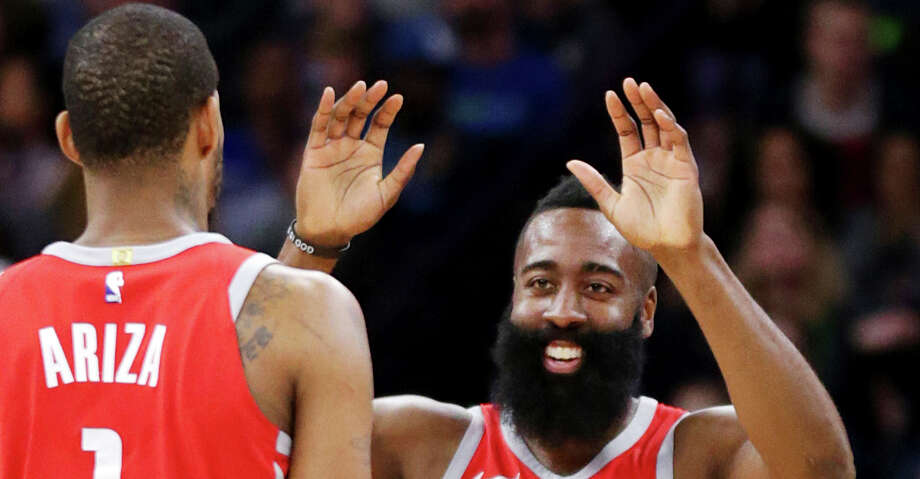 After a strong finishing kick, James Harden and Trevor Ariza had time to celebrate another Rockets win Sunday, this one capping a season sweep of the Timberwolves. Photo: Andy Clayton-King/Associated Press