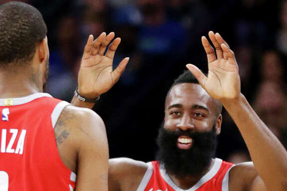 Houston Rockets James Harden (13) celebrates with teammate Trevor Ariza (1) after hitting a three-point shot against the Minnesota Timberwolves in the fourth quarter of an NBA basketball game Sunday, March 18, 2018, in Minneapolis. The Rockets defeated the Timberwolves 129-120. (AP Photo/Andy Clayton-King)