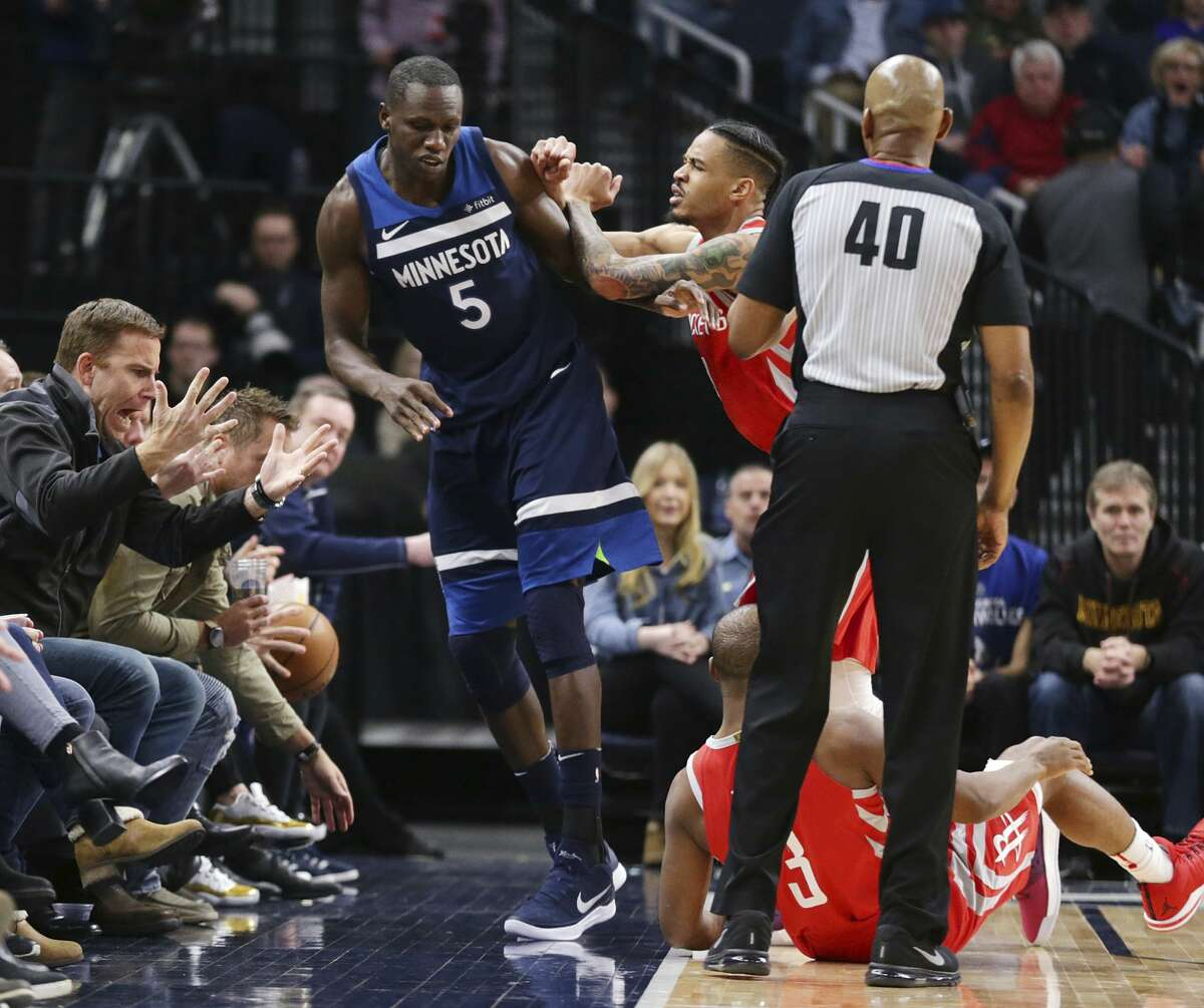 Minnesota Timberwolves center Gorgui Dieng (5) is pushed by out of bounds by Houston Rockets forward Gerald Green (14) after Dieng had caused Houston's Chris Paul (3) to fall during the fourth quarter of an NBA basketball game Sunday, March 18, 2018, in Minneapolis. Green was ejected. The Rockets defeated the Timberwolves 129-120. (AP Photo/Andy Clayton-King)