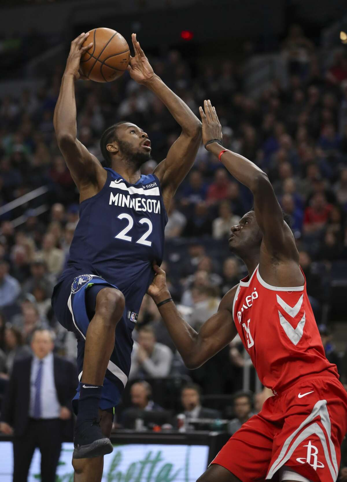 Minnesota Timberwolves forward Andrew Wiggins (22) shoots over Houston Rockets center Clint Capela (15) in the first quarter on Sunday, March 18, 2018 at Target Center in Minneapolis, Minn. The Timberwolves lost to the Rockets, 129-120. (Jeff Wheeler/Minneapolis Star Tribune/TNS)