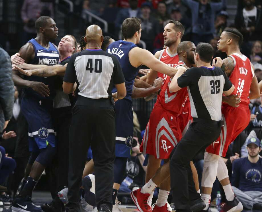 Timberwolves center Gorgui Dieng (left) and Houston Rockets forward Gerald Green (far rigth) are restrained following a fracas during the fourth quarter Sunday that resulted in Green's ejection. Photo: Andy Clayton-King/Associated Press