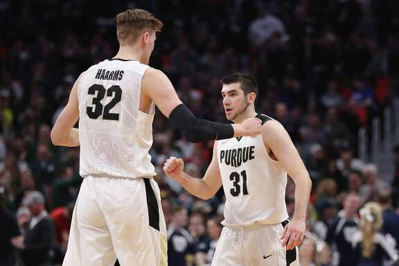Purdue's Dakota Mathias, right, made a key 3-pointer with 14.2 seconds left, lifting Matt Haarms and their teammates to victory.