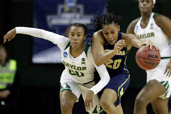 Baylor's Juicy Landrum, left, chases after Michigan's Deja Church (20) in the first half of a second-round game at the NCAA women's college basketball tournament in Waco, Texas, Sunday, March 18, 2018. (AP Photo/Tony Gutierrez)