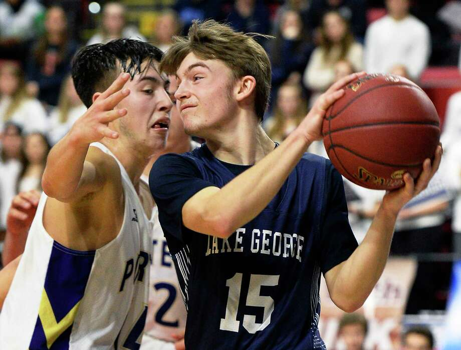 Lake George's #15 Alex Jones battles Greenport's #14 Jordan Fonseca during their Class C state semifinal Friday March 16, 2018 in Binghamton, NY.  (John Carl D'Annibale/Times Union) Photo: John Carl D'Annibale / 20043213A