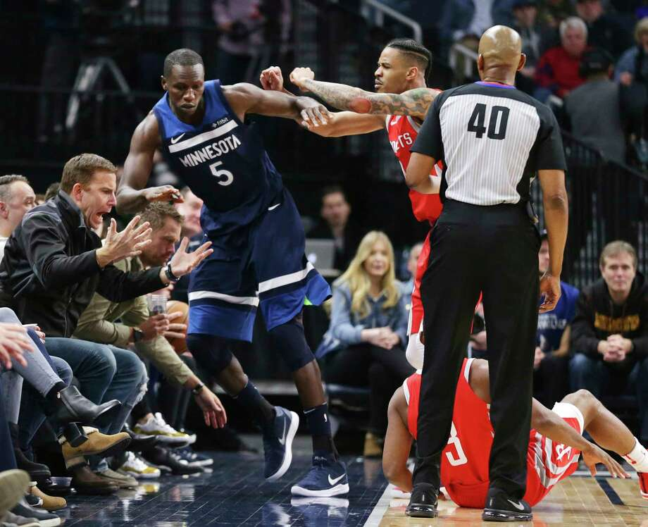 Timberwolves center Gorgui Dieng (5) is pushed out of bounds by the Rockets' Gerald Green after Dieng caused Rockets guard Chris Paul (3) to fall during the fourth quarter of Sunday night's game in Minneapolis. Green was ejected for the shove. Photo: Andy Clayton-King, FRE / FR51399 AP