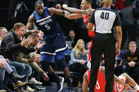 Timberwolves center Gorgui Dieng (5) is pushed out of bounds by the Rockets' Gerald Green after Dieng caused Rockets guard Chris Paul (3) to fall during the fourth quarter of Sunday night's game in Minneapolis. Green was ejected for the shove.