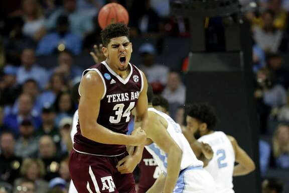 "Center Tyler Davis scored 18 points in Texas A&M's rout of North Carolina on Sunday and said afterward: ""The coaches told us you have to keep pounding it inside. … Keep doing what you do, because they really didn't want to handle us today."""