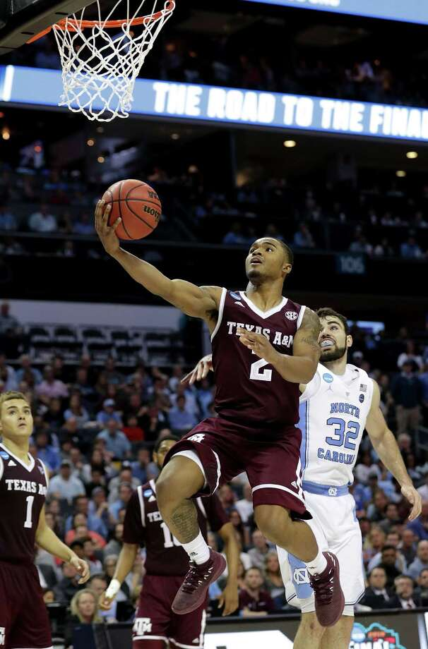 CHARLOTTE, NC - MARCH 18:  TJ Starks #2 of the Texas A&M Aggies lays up a shot against the North Carolina Tar Heels during the second round of the 2018 NCAA Men's Basketball Tournament at Spectrum Center on March 18, 2018 in Charlotte, North Carolina.  (Photo by Streeter Lecka/Getty Images) Photo: Streeter Lecka / 2018 Getty Images