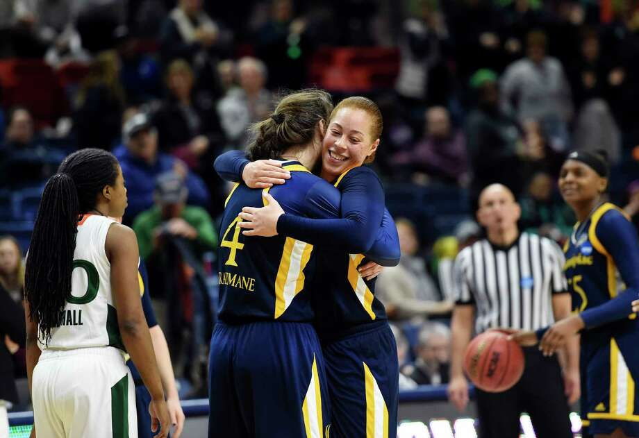 Quinnipiac's Paula Strautmane (4) and Jen Fay (21) embrace after their 86-72 win over Miami in a first-round game at the NCAA women's college basketball tournament in Storrs, Conn. Saturday, March 17, 2018. (AP Photo/Stephen Dunn) Photo: Stephen Dunn / FR171426 AP