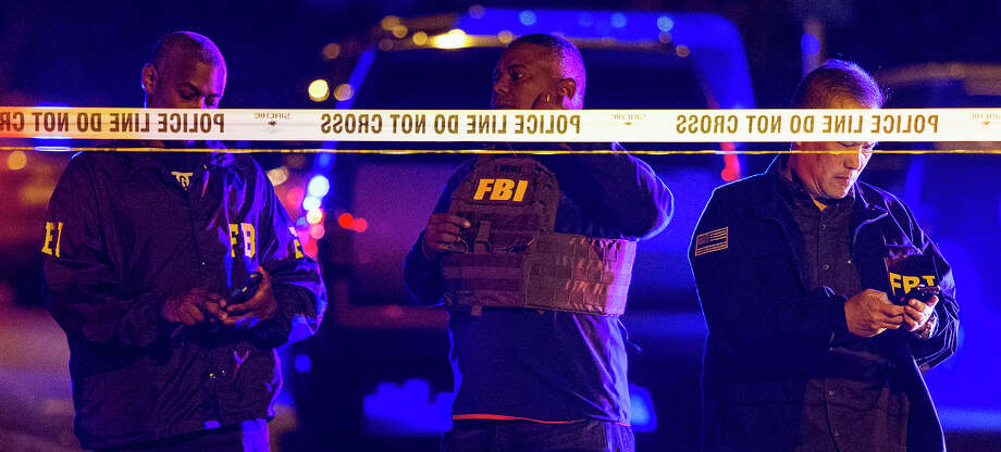 FBI agents work the scene of an explosion in Austin, Texas, Sunday, March 18, 2018. At least a few people were injured in another explosion in Texas' capital late Sunday, after three package bombs detonated this month in other parts of the city, killing two people and injuring two others. (Nick Wagner/Austin American-Statesman via AP) Photo: Nick Wagner, Associated Press / Austin American-Statesman