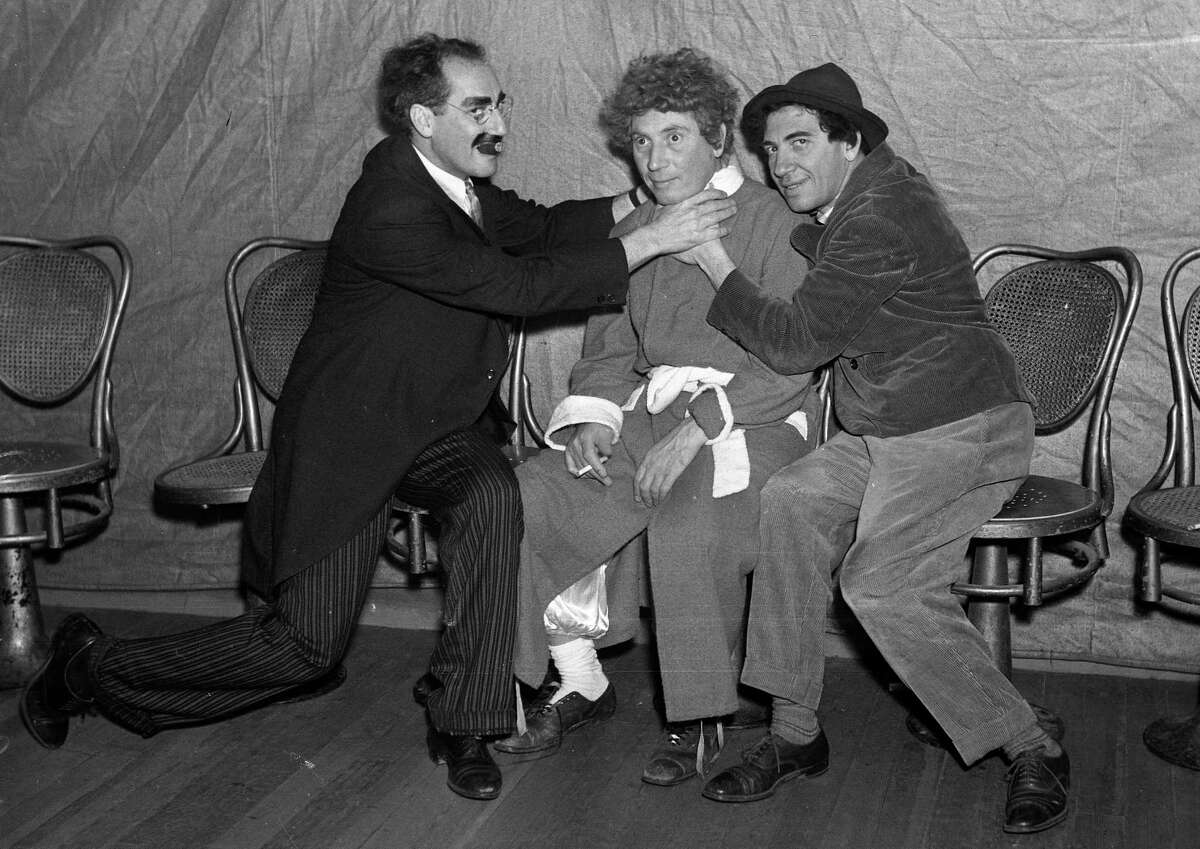 """Groucho, Harpo and Chico Marx perform """"A Day at the Races"""" at the Golden Gate Theatre on Aug. 18, 1936."""