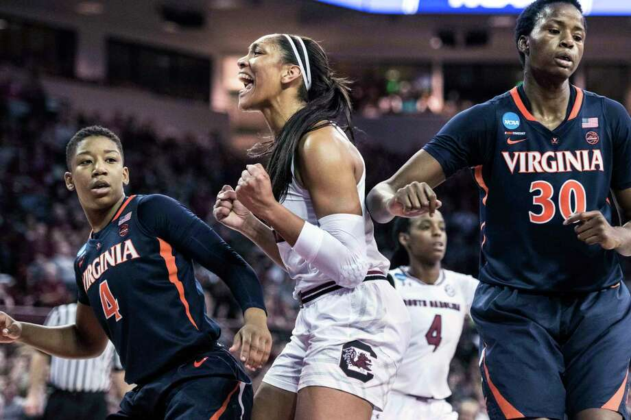 South Carolina forward A'ja Wilson, center, celebrates a basket against Virginia guard Dominique Toussaint (4) and Felicia Aiyeotan (30) during the first half of a game in the second-round of the NCAA women's college basketball tournament, Sunday, March 18, 2018, in Columbia, S.C. (AP Photo/Sean Rayford) Photo: Sean Rayford / The Associated Press