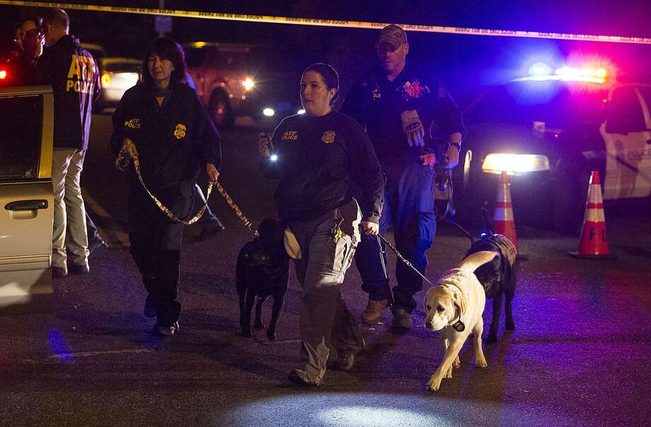 Police dogs and their handlers deploy at the scene of an explosion in southwest Austin, Texas, Sunday, March 18, 2018. Injuries were reported in the explosion, this one coming after three package bombs detonated earlier in the month in other areas of the city, killing two people and injuring two others. (Nick Wagner/Austin American-Statesman via AP) Photo: Nick Wagner, Associated Press
