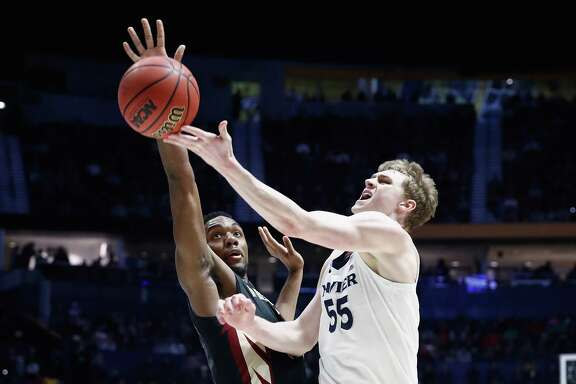 Xavier's J.P. Macura, right, goes up for a shot against Florida State's Trent Forrest in the second half of Sunday night's game at Nashville, Tenn.