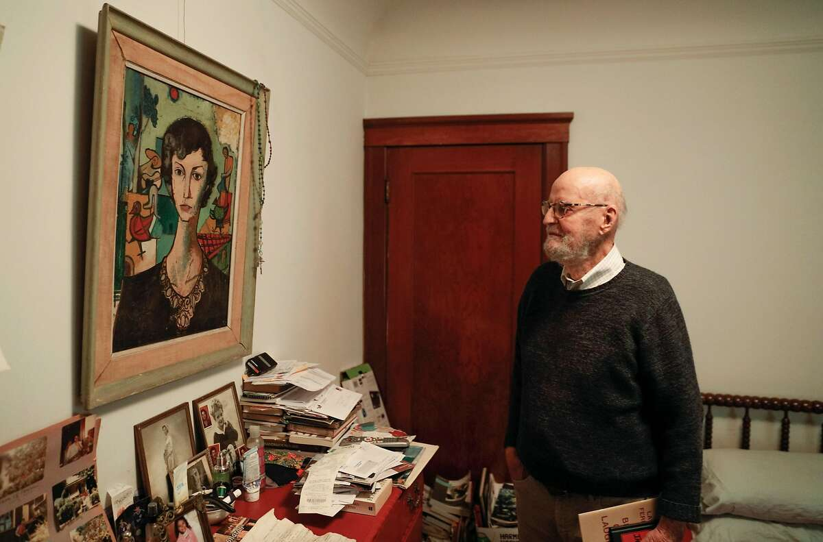 Lawrence Ferlinghetti admires a painting of his late wife, Selden Kirby-Smith, in a bedroom in his apartment. His son Lorenzo stays in the room roughly four days a week.