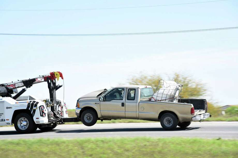 A Ford F-250 is towed after the driver collided with an 18-wheeler on Mines Road on Friday. Photo: Christian Alejandro Ocampo /Laredo Morning Times / Laredo Morning Times
