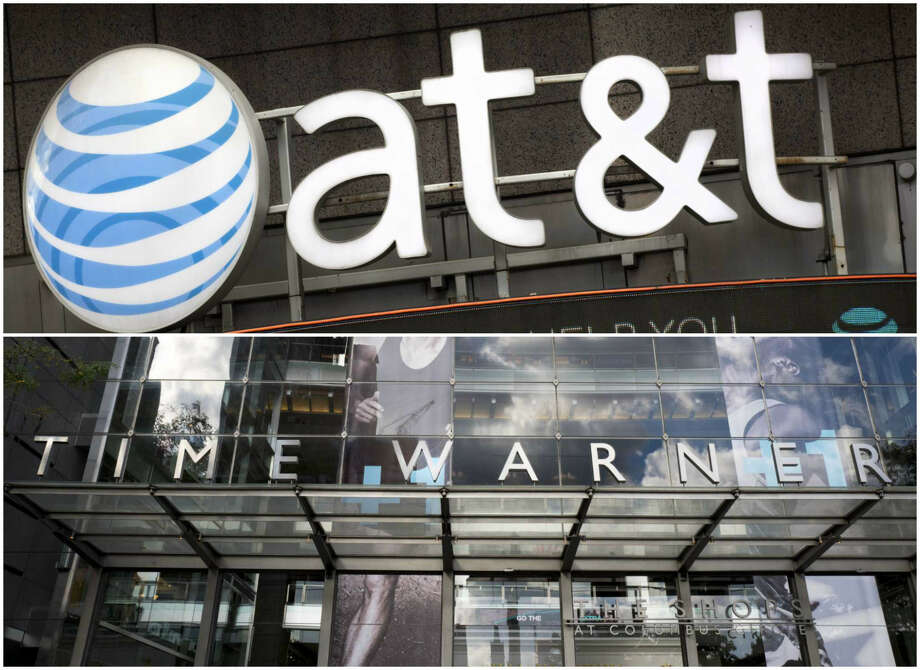 AT&T is battling the Justice Department over its proposed merger with Time Warner Photo: AP Photos