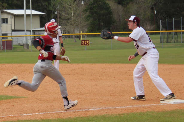 Tarkington Longhorn first baseman Marshall Willis (right) prepares for the incoming ball to take out a Diboll Lumberjack sprinting to first base during the March 15 baseball game.