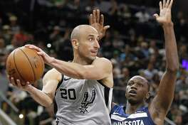 Spurs guard Manu Ginobili looks to pass around the Timberwolves' Gorgui Dieng on Saturday.