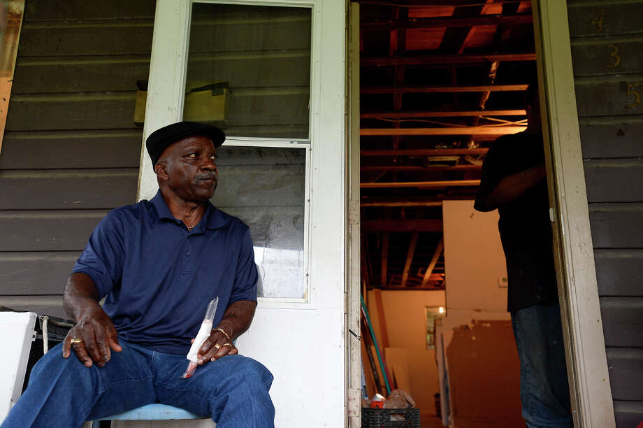 James Royal sits outside his home on Pollard Street in Beaumont's north end neighborhood, which is still being repaired from Tropical Storm Harvey flooding. Royal said he wouldn't take a buyout if it was offered, since the home was a graduation gift from his parents.  Photo taken Monday 3/5/18 Ryan Pelham/The Enterprise Photo: Ryan Pelham / ©2017 The Beaumont Enterprise/Ryan Pelham