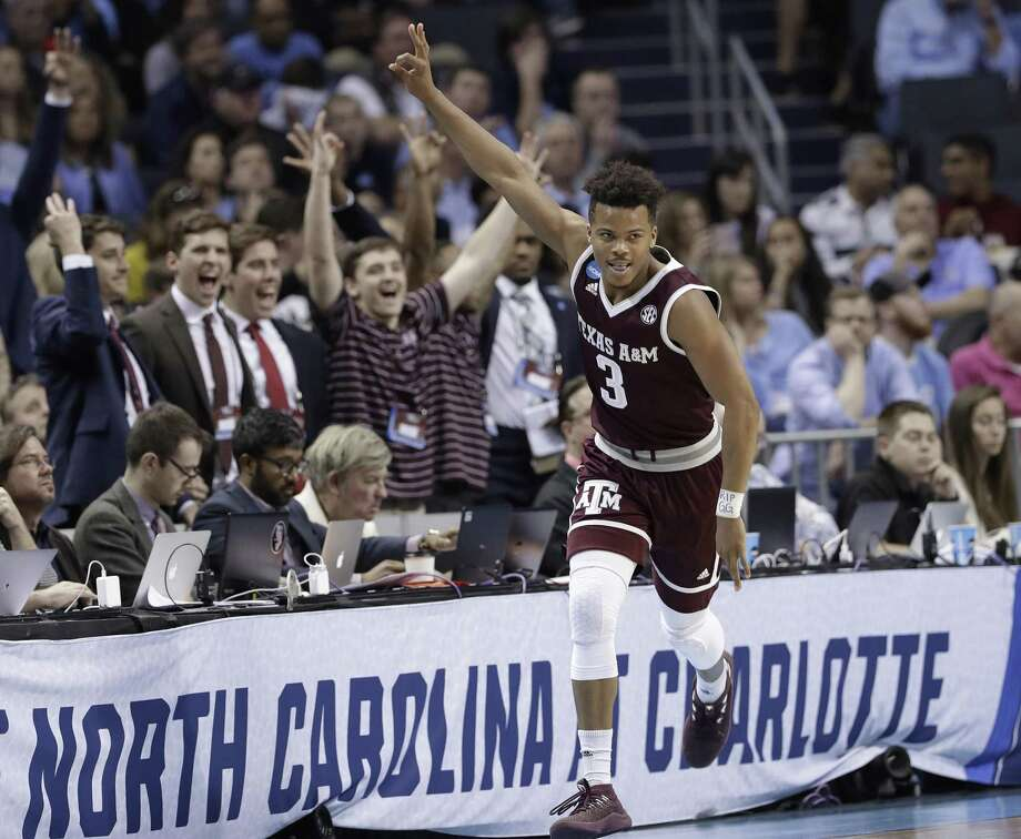 Texas A&M's Admon Gilder reacts to making a three-point basket against North Carolina during the second half. Photo: Gerry Broome / Associated Press / Copyright 2018 The Associated Press. All rights reserved.