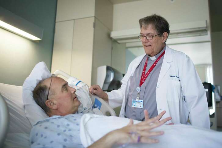 Deacon Bill Wilson listens to Scot Hux (cq), a patient at CHI St. Luke's Health, Monday, March 12, 2018, in Houston. CHI St. Luke's Health has awarded a one-time grant of $900,000 to Archdiocese of Galveston-Houston to provide more trained Catholic lay chaplains and pastoral visitors for patients. ( Marie D. De Jesus / Houston Chronicle )
