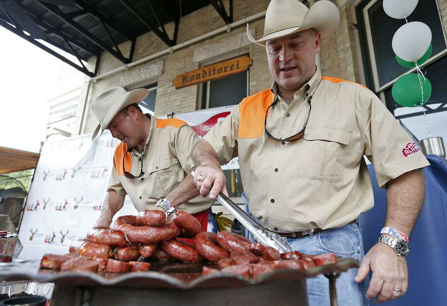 Alamo Market & Lockers co-owners John Canavan and David White prepare samples during the Wild Game Sausage Showdown at Beethoven Maennerchor. Photo: Edward A. Ornelas /San Antonio Express-News / © 2018 San Antonio Express-News