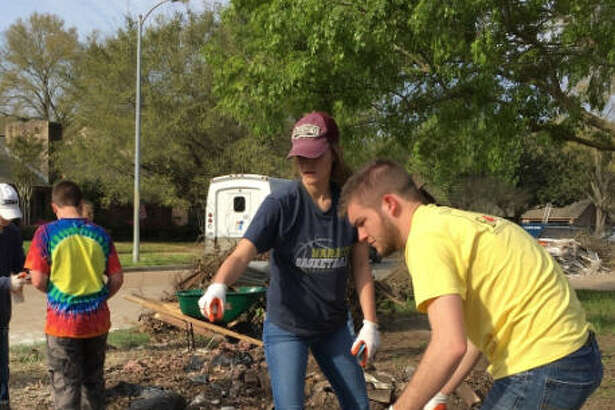 Blair and Logan Lamb clear debris from a home in the 15600 block of Tumbling Rapids Drive on March 13. Logan is youth minster at First Baptist Church ofCorsicana. The couple led a group of 18 people during spring break to help the Bear Creek neighborhood.