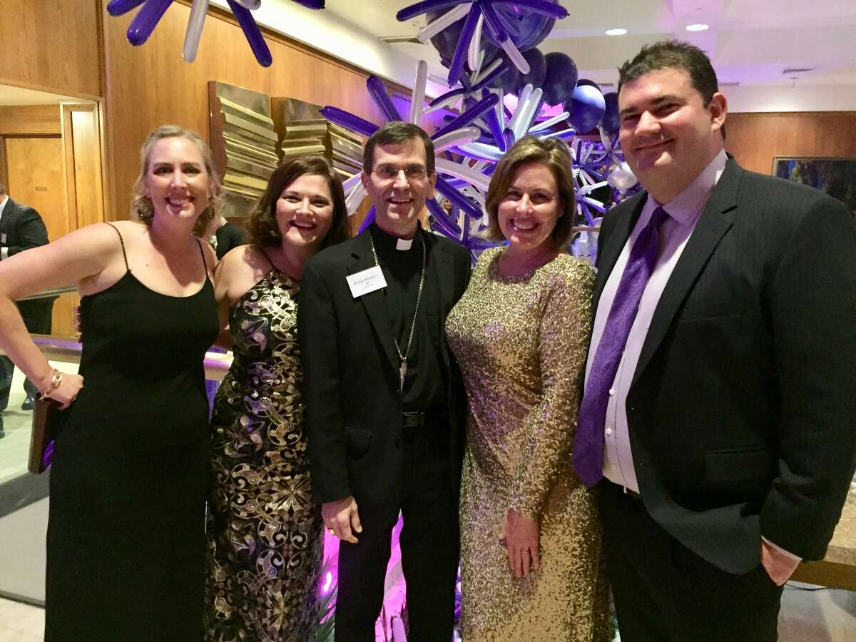 Mardi Gras: Greta Fischer, Mary Baker, Bishop Michael Sis and Michelene and Wade McCool