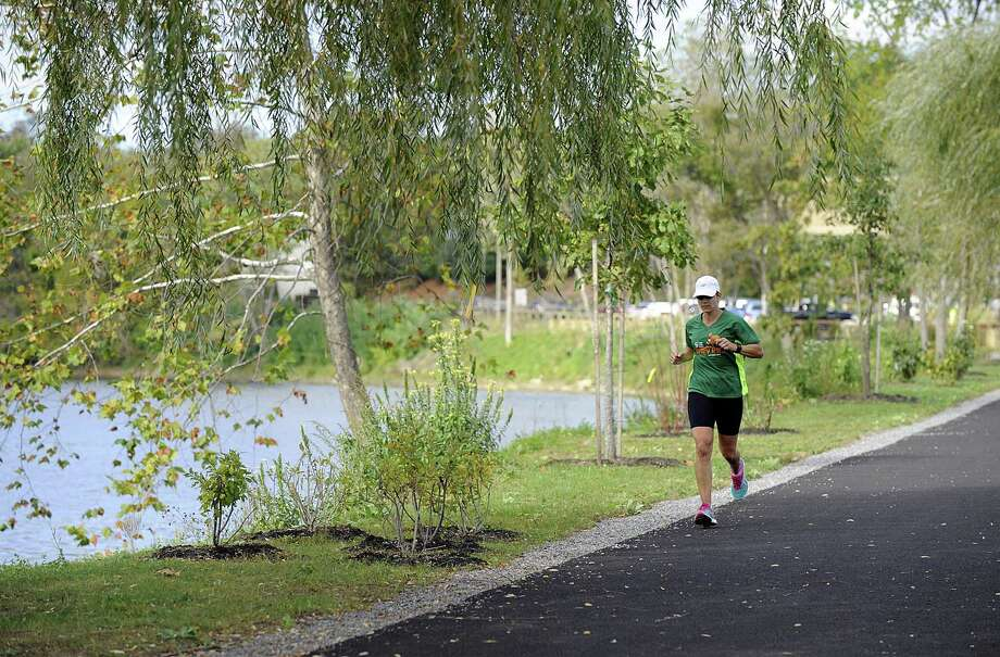 A runner uses the Young's Field Riverwalk in New Milford on Friday, Oct. 13, 2017. Photo: Carol Kaliff / Hearst Connecticut Media / The News-Times