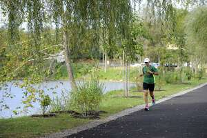 A runner uses the Young's Field Riverwalk in New Milford on Friday, Oct. 13, 2017.