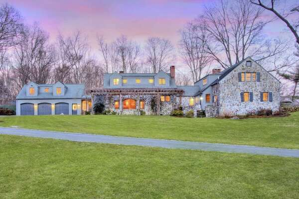 The Frazier Forman Peters' stone house at 21 Broad Street in lower Weston has 5,065 square feet of living space and six bedrooms.