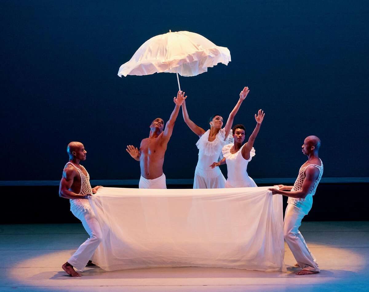 """Members of the Alvin Ailey American Dance Theater in Ailey's classic """"Revelations,"""" performed during the company's run at UC Berkeley's Zellerbach Hall through Sunday, April 15. Photo: Paul Kolnik"""