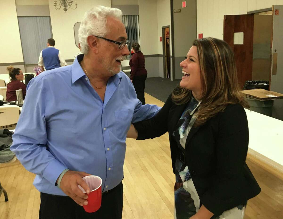 Danny Salerno, left, New Britain board of aldermen majority leader, and Erin Stewart, the mayor, talked about hometown sons George Springer III and Paul Manafort Jr. at a political fundraiser Thursday, Nov. 2, 2017.