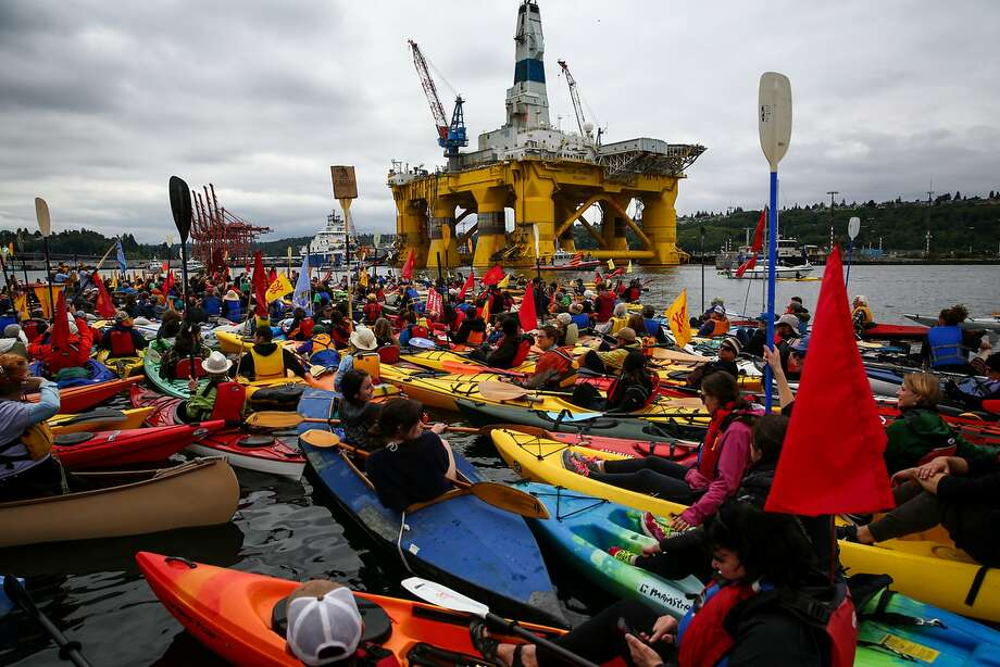 People in kayaks protest against the Port of Seattle being used as a port for Shell Oil's Arctic drilling rig Polar Pioneer in May 2015. Photo: DANIELLA BECCARIA, SEATTLEPI.COM