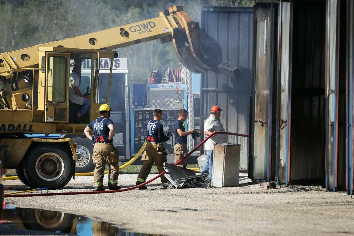 Firefighters extinguish the last remaining hotspots of a fire that destroyed 72 storage units on Monday, March 19, 2018, at Piney Woods Boat and RV Storage in Willis.