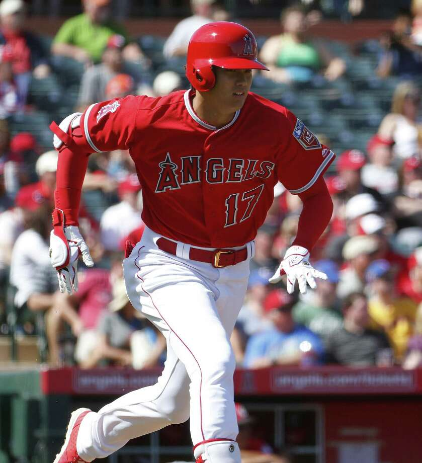 Los Angles Angels' Shohei Ohtani runs against the Cincinnati Reds during the second inning of a spring training baseball game Monday, March 12, 2018, in Tempe, Ariz. (AP Photo/Matt York) Photo: Matt York, STF / Associated Press / Copyright 2018 The Associated Press. All rights reserved.