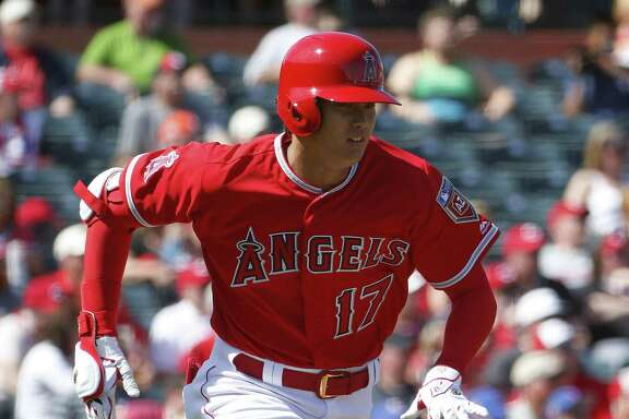 Los Angles Angels' Shohei Ohtani runs against the Cincinnati Reds during the second inning of a spring training baseball game Monday, March 12, 2018, in Tempe, Ariz. (AP Photo/Matt York)