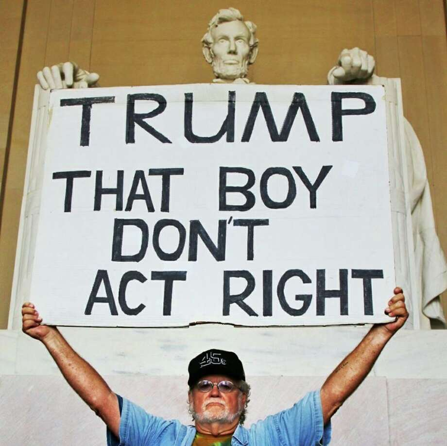 Gale McCray, 75, holds his sign at the Lincoln Memorial. Photo: Courtesy: Gale McCray