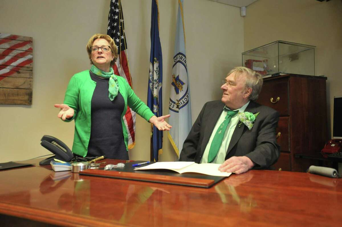 Torrington Mayor Elinor Carbone, left, speaks about Owen Canfield, as he was celebrated as the 2018 Lord Mayor on Monday, celebrating both St. Patrick's Day and his longtime service to the community.