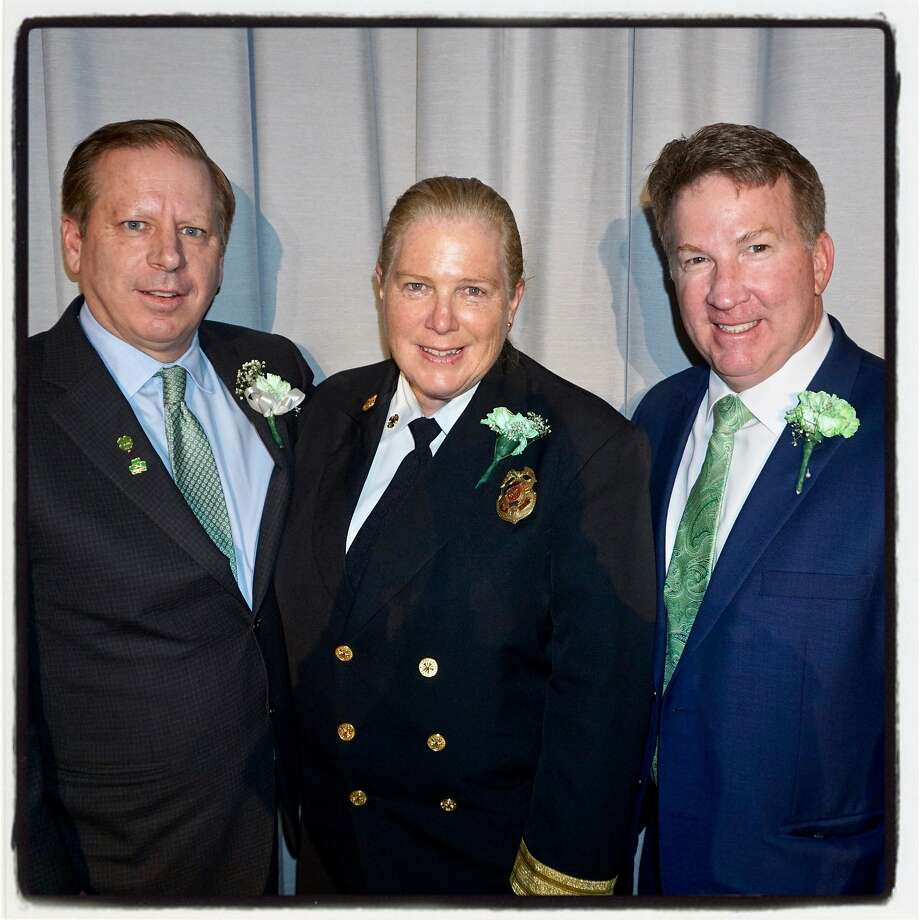 Hibernian Newman Club President John Ring (left), SFFD Chief Joanne Hayes-White and SFPD Capt. Joseph McFadden March 16, 2018. Photo: Catherine Bigelow, Special To The Chronicle