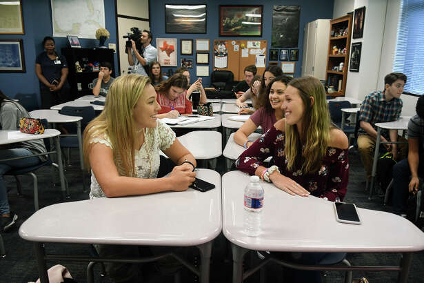 Kingwood High School juniors Melissa Reeves, 17, from left, Marissa Amar, 17, Student Body President, and Hannah Cook, 16, are all smiles as they get ready for a class change after their AP & Dual Credit History class taught by teacher Mark Scalia on their first day back on the KHS campus for the 2017-2018 schoool year on Monday, March 19, 2018. (Photo by Jerry Baker/Freelance)