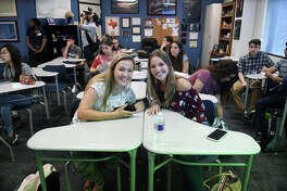 Kingwood High School juniors Melissa Reeves, 17, from left, and Hannah Cook, 16, are all smiles as they get ready for a class change after their AP & Dual Credit History class taught by teacher Mark Scalia on their first day back on the KHS campus for the 2017-2018 schoool year on Monday, March 19, 2018. (Photo by Jerry Baker/Freelance)