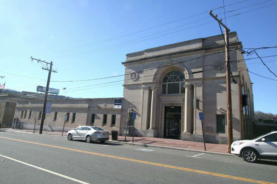 The 12,980-square-foot former home to Bank of America at 115 Main St. in downtown Seymour was sold to a local buyer. Photo: Contributed Photo