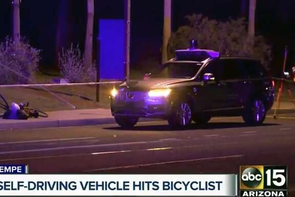 This March 19, 2018 still image taken from video provided by ABC-15, shows investigators at the scene of a fatal accident involving a self driving Uber car on the street in Tempe, Ariz. Police in the city of Tempe said Monday, March 19, 2018, that the vehicle was in autonomous mode with an operator behind the wheel when the woman walking outside of a crosswalk was hit. (ABC-15.com via AP)